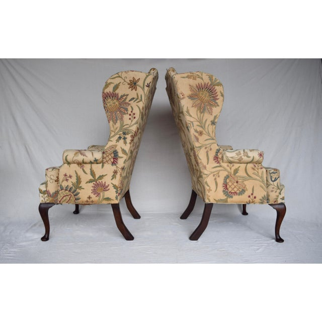 Lithe, stately Queen Anne English wingback chair circa 1910. The chair stands on Mahogany cabriole front legs with pad...