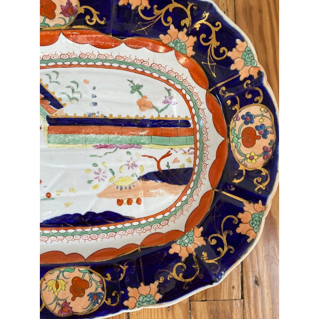 Very special, exceptionally large, mid 19th century masons ironstone well and tree meat platter in the documented colored...