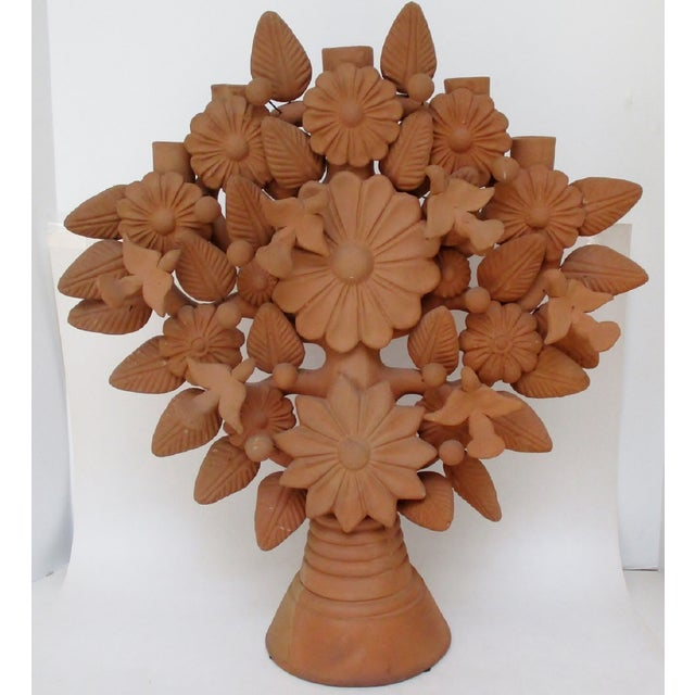 Large Mexican terracotta 'tree of life' candelabra, decorated with added birds, leaves and berries on adjustable wires....
