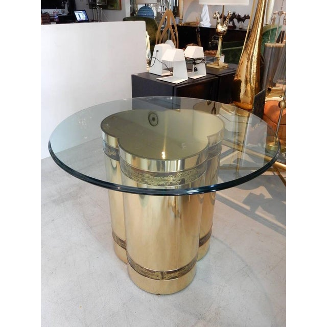 """Polished brass with iconic Bernhard Rohne acid etched decoration. 36"""" glass top included. Very versatile table, use it..."""