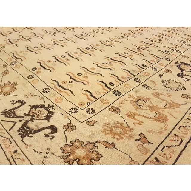 This mesmerizing rug has been hand knotted using the finest quality hand spun wool in a unique, versatile design featuring...