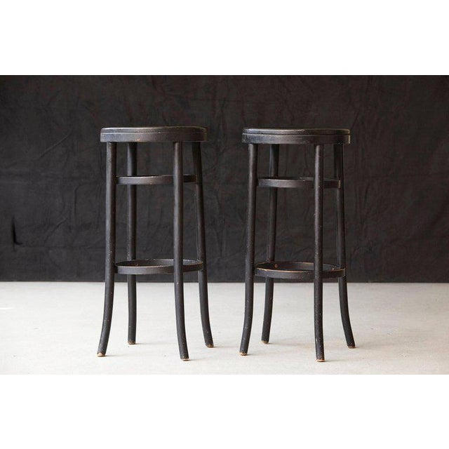 Nice pair of original Thonet black bentwood bar stools. The stools are in solid condition and show some wear and patina....