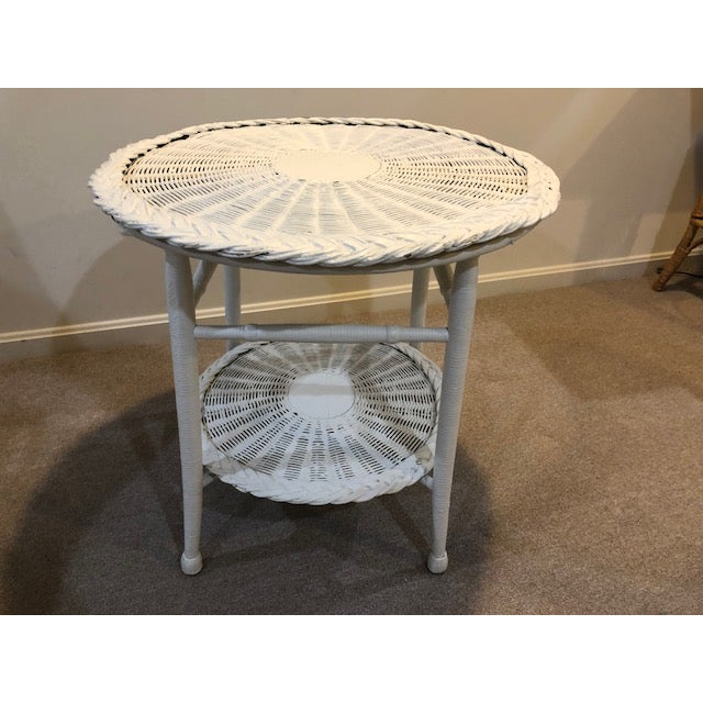Beautiful vintage white wicker two tier table. Round. Painted in white. Perfect for a sunroom, porch or deck.