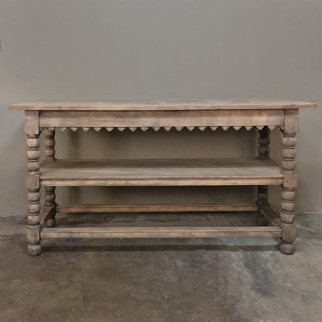 Early 19th Century Rustic Renaissance Stripped Oak Counter features three surfaces, sturdy spooled legs, and a mid-height...