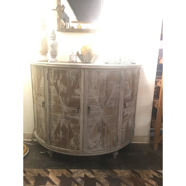 This distressed light grey demi-lune cabinet is a wonderful piece made by Furniture Classics. Unlike most demi-lunes, it...