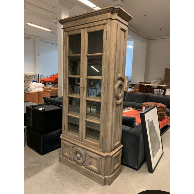 Design Plus Gallery presents a New Custom Design Wallace Display Cabinet. Tall and stately, the grey oak cabinet has...
