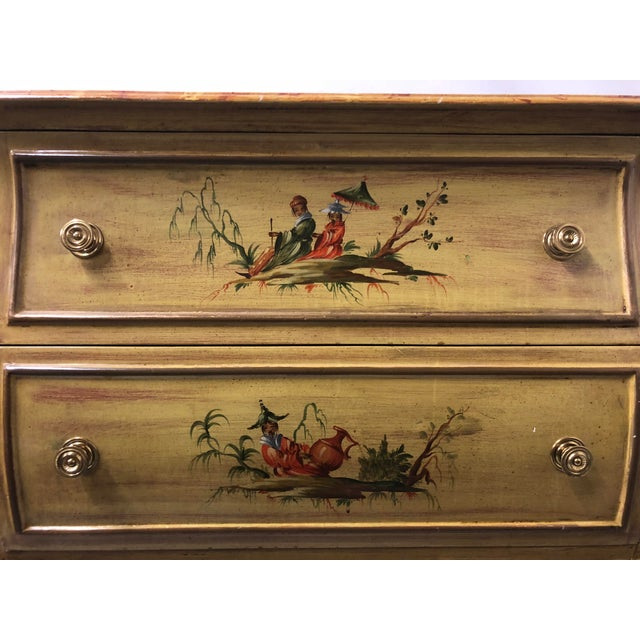 1970s Italian hand painted chest of drawers with chinoiserie scenes on the front and sides. The top is a faux marble...
