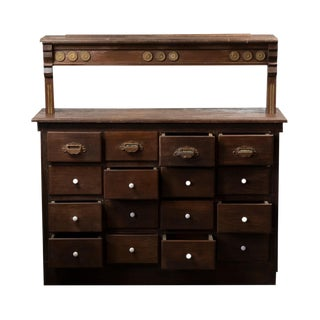 1920s Traditional Wooden Apothecary Cabinet With Ornate Cast Iron Drawer Pulls For Sale
