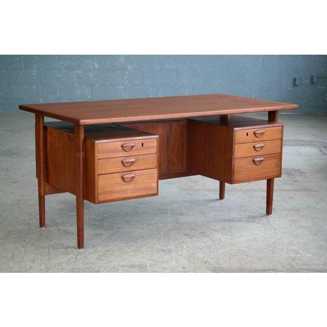 Beautiful Danish executive desk in teak designed in 1958 by Kai Kristiansen for Feldballe's Møbelfabrik as Model FM60....