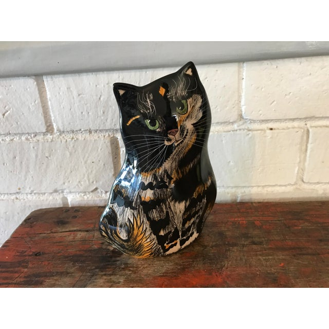 Collectible Cats by Nina vase by artist Nina Lyman. This one is of a Tortie or Tortoise shell colored kitty with green...