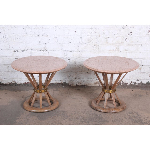 A gorgeous pair of mid-century modern sheaf of white side tables in the manner of Edward Wormley for Dunbar . The tables...