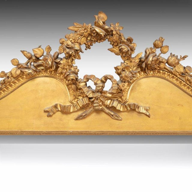 This mirror is circa 1850/60 and retains the original gilding that is a lovely soft tone. It has a simply carved frame...