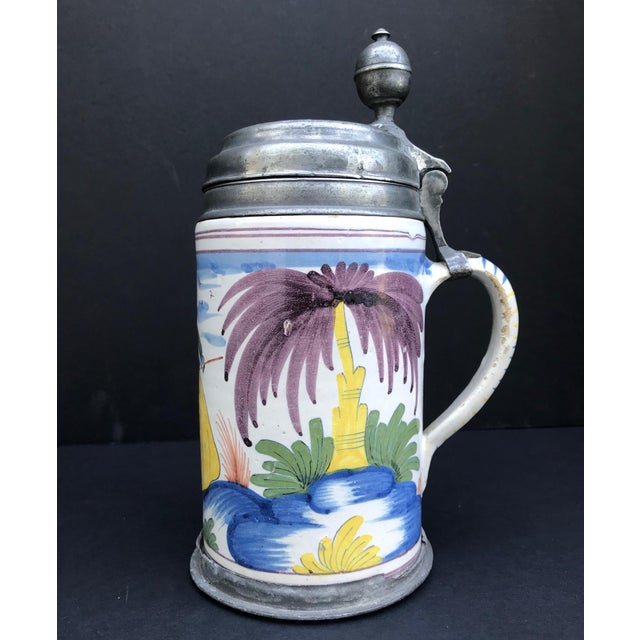 This tankard from the 3rd quarter 18th century is of cylindrical form with the handle mounted in pewter. The place of...