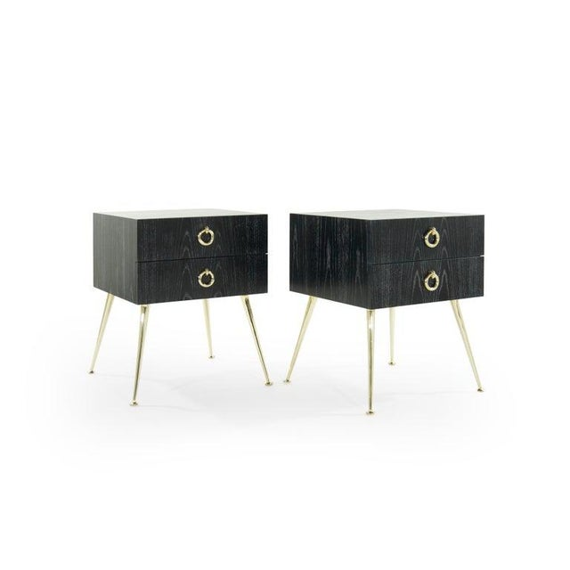 """The """"Gibby"""" end tables features a solid oak structure a top four tapered, hand casted, polished brass legs. Dual drawer..."""