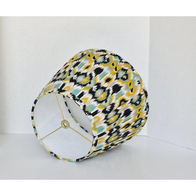 - New, custom, handcrafted lampshade - Fabric: Ikat Fabric. Colors include yellow, white, black, and blue. - Lining: White...