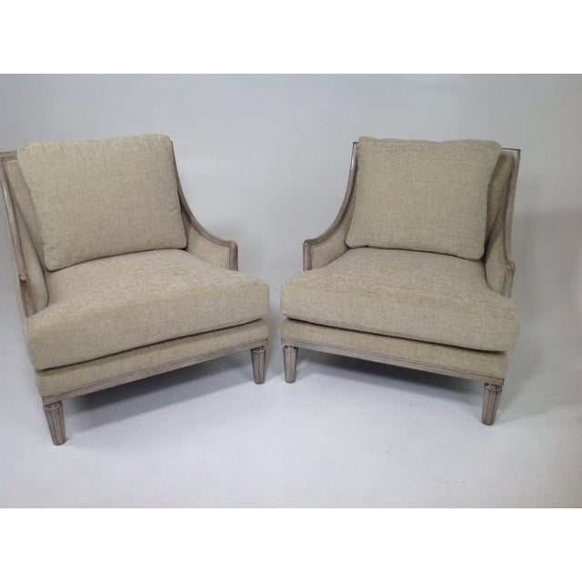 Stunning pair of lounge chairs. The chairs have a ceruse grey finish. The fabric is a Robert Allen chenille. The chairs...