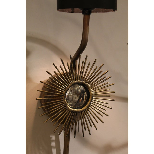 Pair of brass Starburst Scones with a mirror detail in the center. The black lampshades provide a sheek, modern look. Lamp...