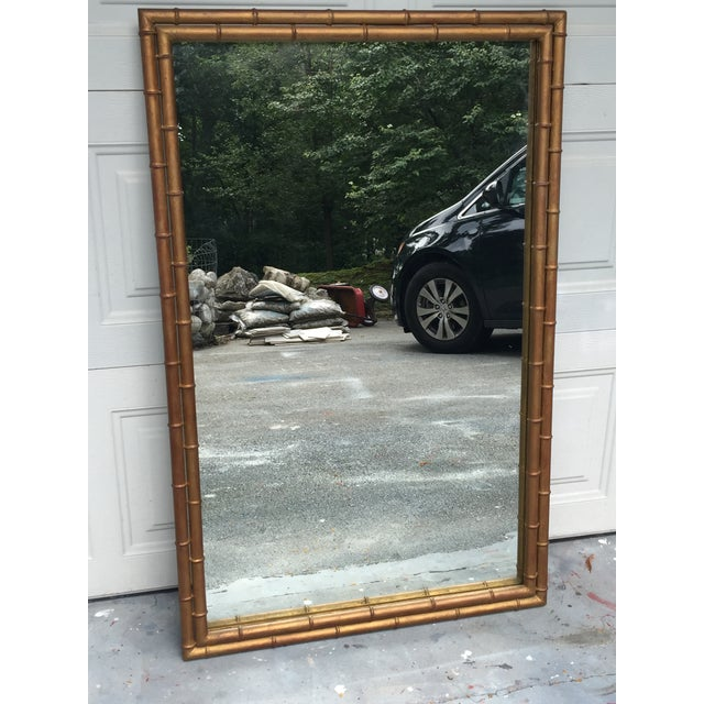 Large master craft style mirror made of metal. Absolute stunning large mirror with faux bamboo hues of bronze gold...