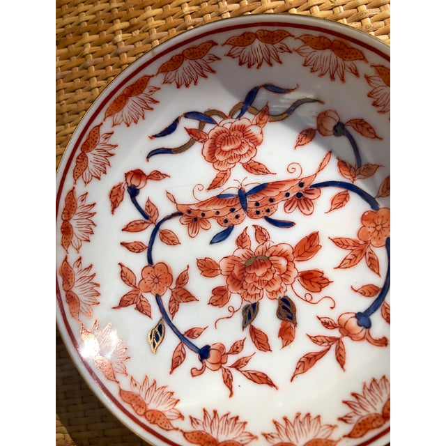 Hand-Painted porcelain dish from Hong Kong for the Ritz Carlton. Has a central butterfly surrounded by floral motifs is...