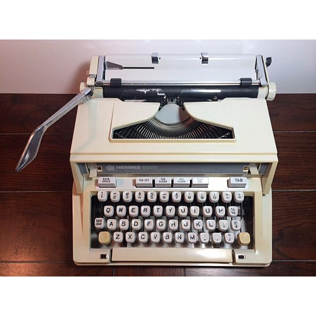 Vintage Hermes 3000 / Media portable typewriter with hard case cover and Manual. It's Serial number 7510759 indicates it...