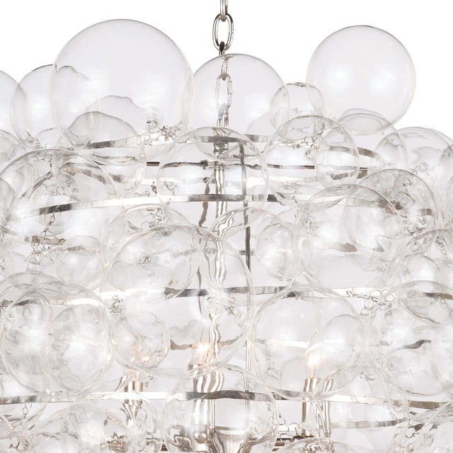 Nimbus chandelier lives up to its name, featuring hundreds of glass balls in varying sizes that create a cloud-like orb,...