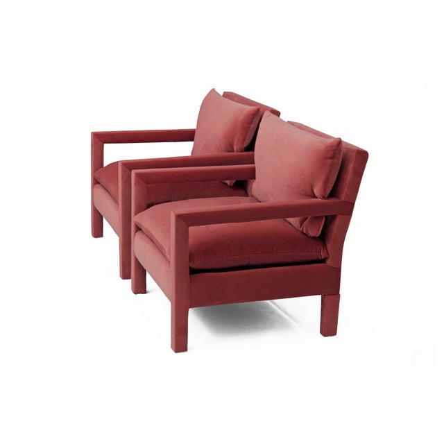 Exceptional pair of 1970's Parson Style Lounge Chairs after Milo Baughman, newly upholstered in a hardy pink cotton...