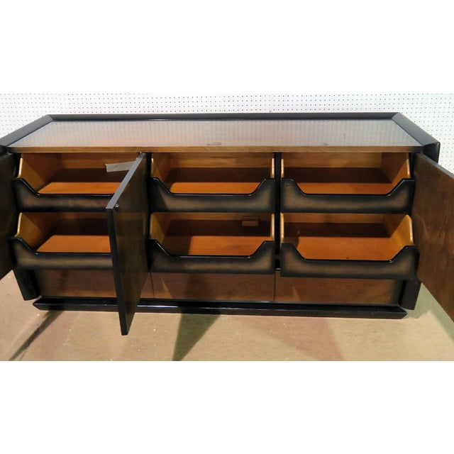 Art Deco dresser with 4 doors, each containing 2 drawers, over 3 drawers.