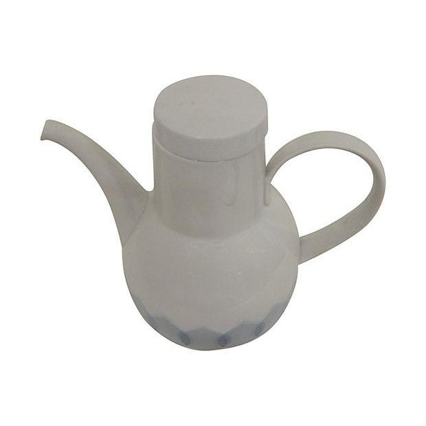 "A 1960s Rosenthal coffeepot designed by Bjørn Wiinblad, soft shades of blue with period design. Maker's mark on base. 6"" L..."