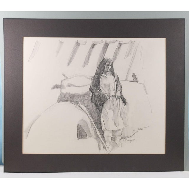 Pencil study on artist board of a Pueblo woman by Brigitte Woosley. Signed lower right. Unframed. Displayed in black mat...