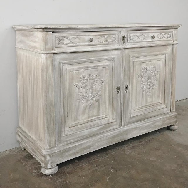 19th Century Country French Louis XVI Whitewashed Buffet was hand-crafted by capable and talented rural artisans in the...