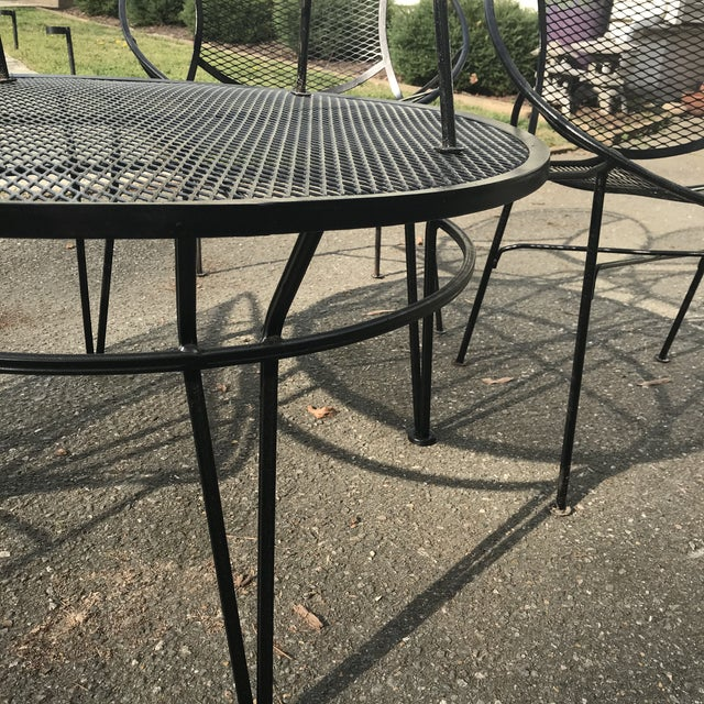 Rare 1950's iron patio set including four chairs and cocktail table designed by Maurizio Tempestini for John Salterini....