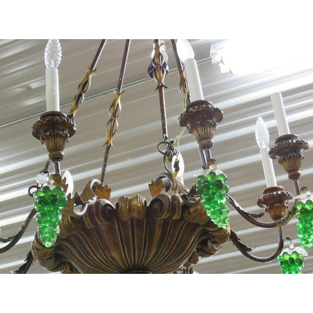 Italian tole and crystal eight-arm chandelier with green glass grapes.