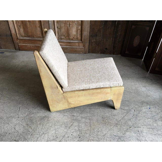 Architectural modernist slipper lounge chair. This piece is in structurally sound and nicely distressed condition. The...