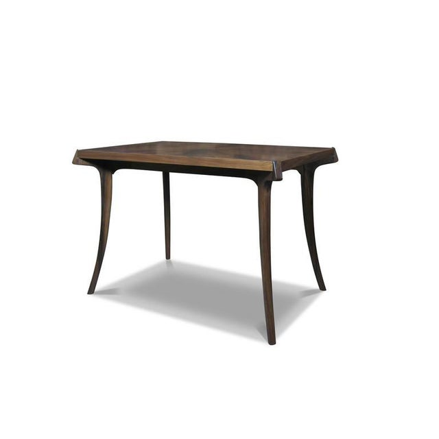The Uccello Writing Desk is handcrafted one by one in Costantini's workshop in Buenos Aires. The surface of the table can...