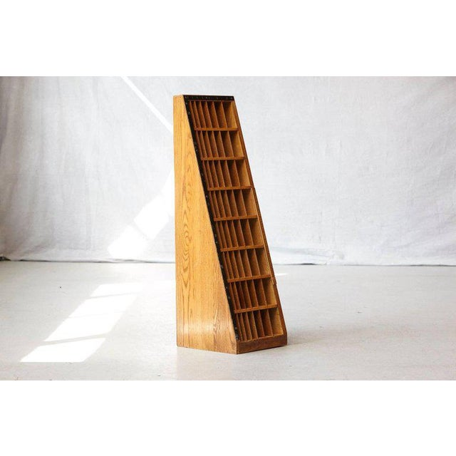 Unusual wooden furniture which has been used for the the storage of differently sized wood blocks. These wood blocks have...
