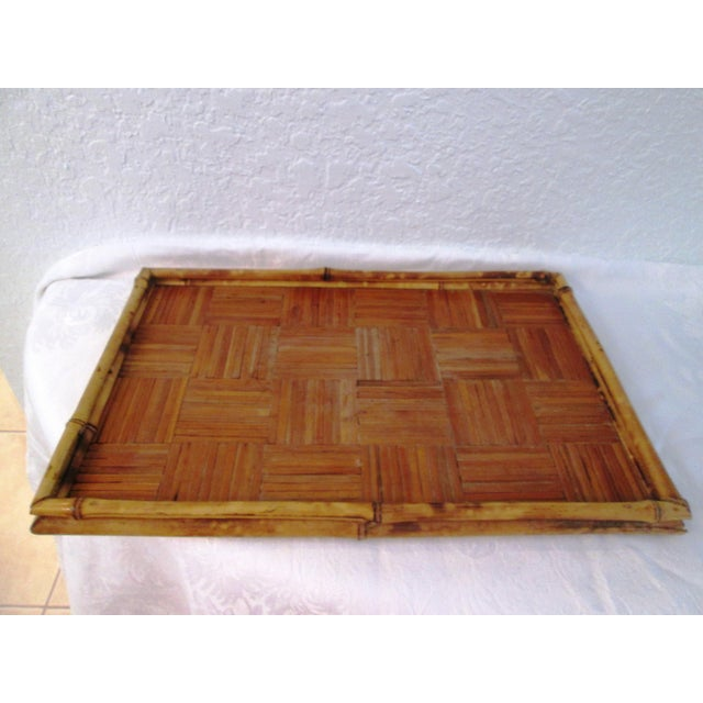 Vintage generous size rattan tray with tortoise bamboo gallery. Very good vintage condition with age wear to rattan...