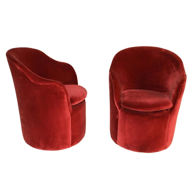 These chic barrel chairs feature circular-form bodies with curved backrests that slope down to integrated arms. Each chair...