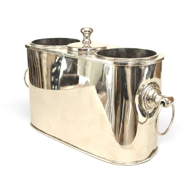 Pair of English art Moderne style (modern) nickel-plate oval wine coolers with a pair of wells centring an opening with a...