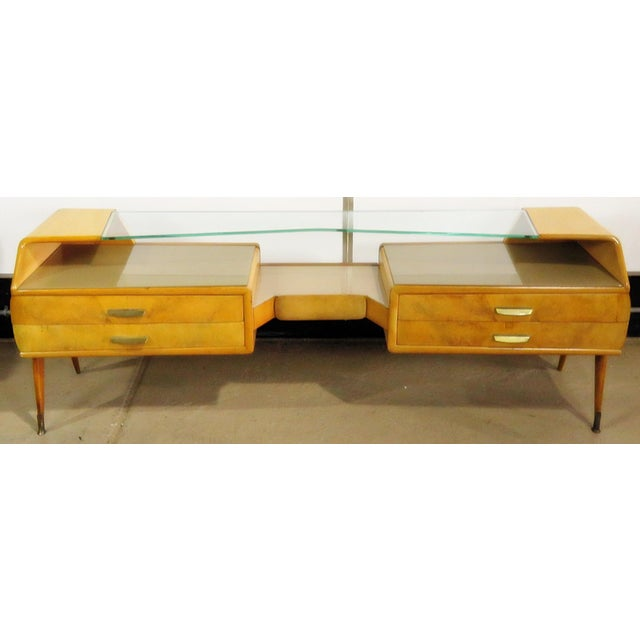 Mid-Century Modern 5 drawer sideboard with a glass top.