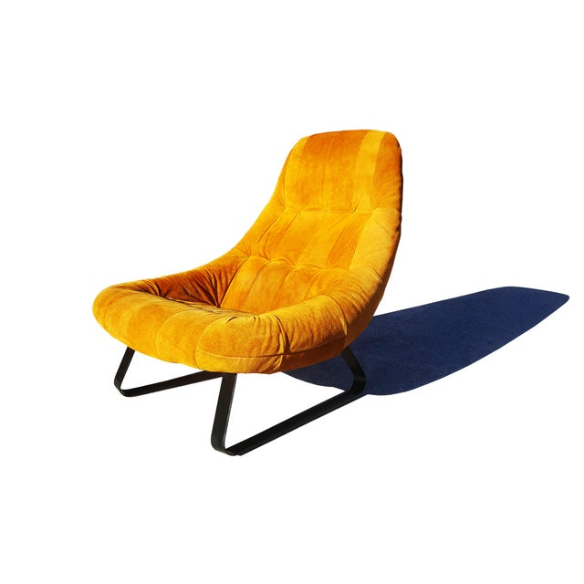 From the Earth Collection, this is an early ergonomically designed lounge chair by Brazilian Percival Lafer, a bucket...