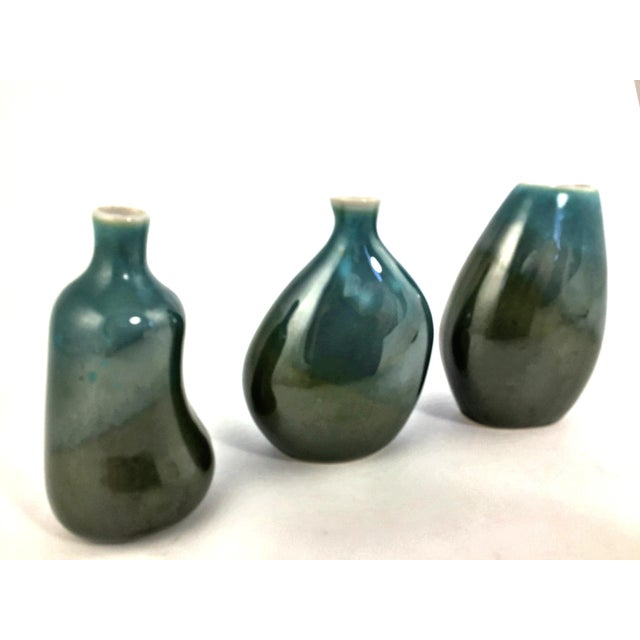 Beautiful glazed set of 3 organic styled mini flower vases. In wonderful condition and no matter how you sit them, they...