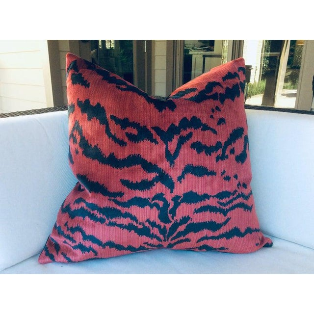 """A striking pair of pillows in plush red """"Le Tigre"""" fabric by Scalamandre. It features decadent silk velvet stripes in..."""