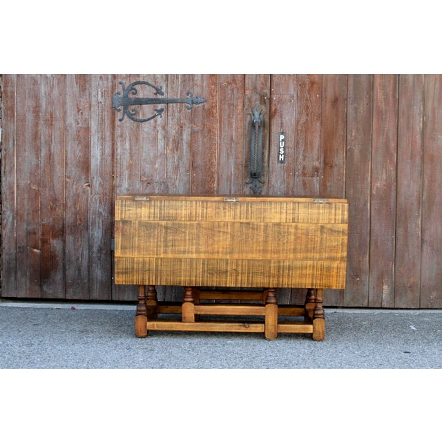 """Midcentury Spanish harvest table featuring a gate-leg mechanism with turned legs, and raised grain on top. Closed, 48"""" x..."""