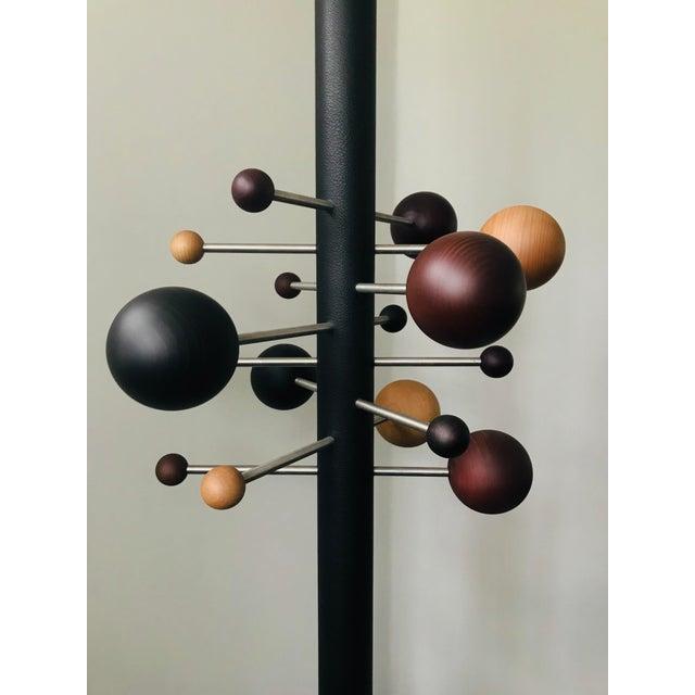2012 Tecno re-edition of the extendable coat rack (model AT16) designed by Osvaldo Borsani in 1961. Aluminum tube pole...