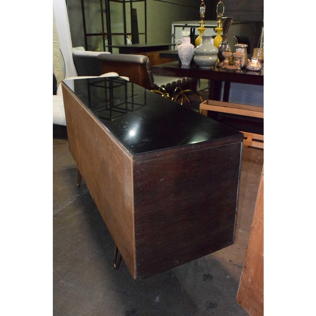 This is a beautiful dresser with lots of interest. The hardware is highly decorative. A protective smoked glass top is...