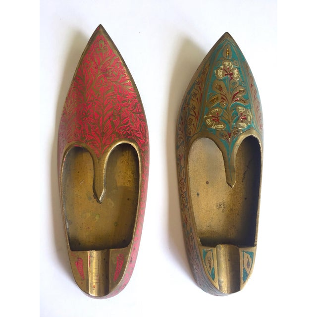 This set of two vintage Mid Century India brass hand incised enamel shoes incense burner ashtrays are a very special and...
