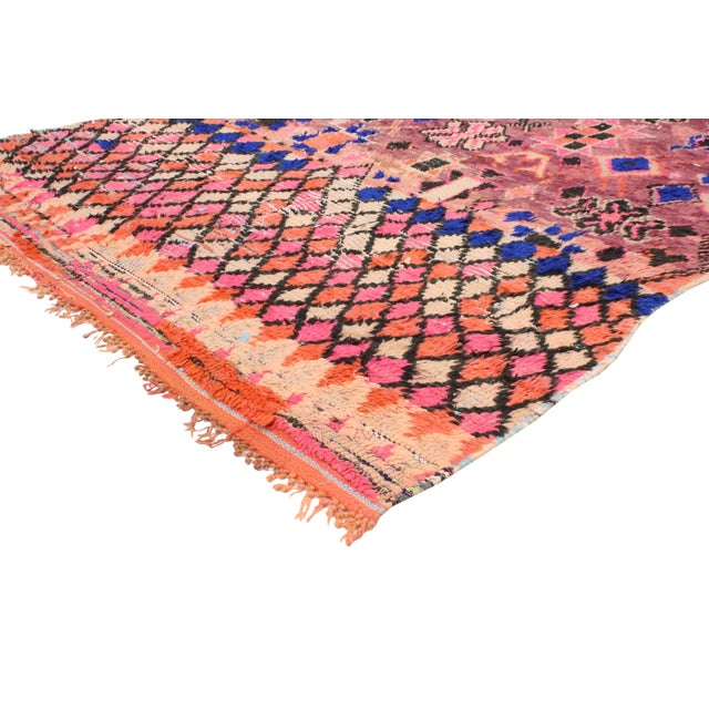 This hand-knotted wool vintage Moroccan rug features an all-over geometric pattern of ancient Berber symbols: diamonds,...