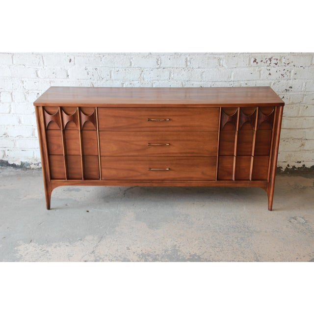 Offering a very nice nine-drawer dresser or credenza by Kent Coffey. This piece is from the Perspecta line and features a...