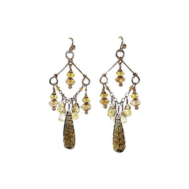 Gold-filled earrings with a long spiral-cut whiskey quartz drop and embellished with faceted citrines and gold-filled...
