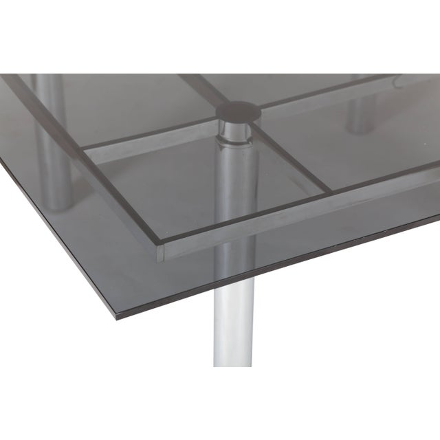 Dining table with solid chrome frame and overhanging black glass tabletop, Designed by Tobia Scrapa for Knoll...